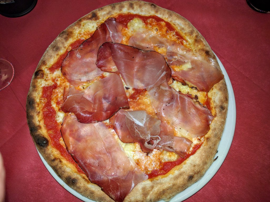 Delicious Italian pizza with cured ham