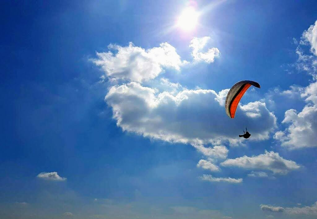 Paraglider high up in the sky