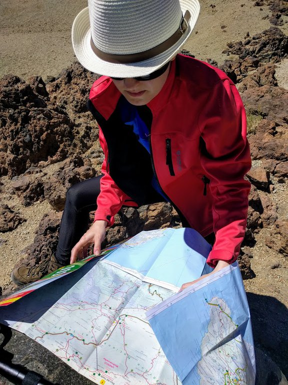 Reading a map while hiking in Teide National Park